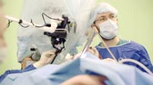 lasik : Team of surgeons during a surgery.