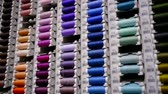 шпуля : many spools of different colors threads, placed on racks in a workshop of atelier making clothes