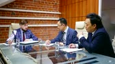 kazak : partners are discussing during negotiations in a meeting room of office, three asian men are looking