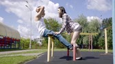 çiftler : training young couples on the Playground outside. doubles sport Stok Video