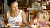 parentalidade : mother and daughter in the restaurant while having a delicious Breakfast