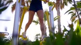 playground : Close up shot of a woman working out on the special sports ground on vacation.