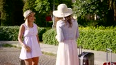 lifestyle : Funny charming women standing on a street talking and laughing.