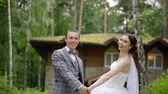vinha : happy couple husband and wife in wedding clothes came to his country house. young successful family people Vídeos