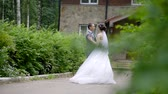 threshold : wedding day successful young couples dance in formal attire at the threshold of his rustic home in the woods