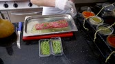 bonfile : cook prepares beef tenderloin for cooking. lubricate with oil, sprinkle with salt and spices Stok Video