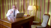 mobile kitchen : Angry businessman with laptop and documents talking on cellphone at home at night