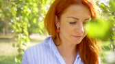 рыжеволосый : Sun adult smiling woman with red hair looking at camera smile . summer face sunset beautiful lady outdoor closeup