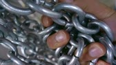 acorrentado : shiny steel chain wrapped around the arm