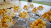 bakery shop : sweet desserts in a glasses are standing on rack in restaurant during dinner Stock Footage