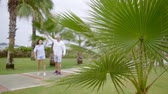 atitude : happy couple dancing in the tropical gardens amid palm trees in a long-awaited vacation