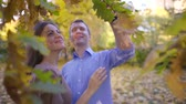 cherish : Cute couple in love in beautiful autumn park.