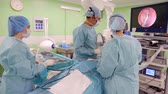 iç : doctors are watching a tumor inside a head of patient using endoscopic camera in surgery room