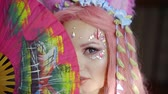 geisha : pretty cartoon style geisha with pink hair is playing with japanese paper fan, flirting with camera