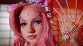 personage : charming caucasian girl with creative makeup with crystals, looking like anime character, close-up Stock Footage