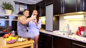 mobile kitchen : Attractive young couple taking selfie at home in kitchen. Happy Young Couple Pose For Selfies inside. Young man and woman making selfies