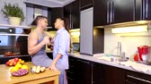 atitude : young girl and guy cute talking in the kitchen, drinking tea