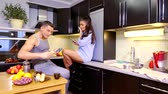 curlers : Lovely couple hanging out in kitchen in the evening. Stock Footage