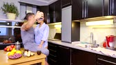 mobile kitchen : happy joyful lovers are taking selfies by mobile phone on kitchen of home in morning time
