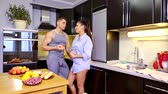 beloved : young man is taking photos with his beloved wife in kitchen in evening time, he is using smartphone Stock Footage
