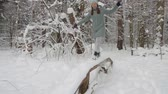 winter girl : Happy adult woman having fun in a winter forest alone, witner weekends. Stock Footage