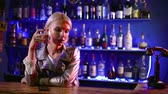 girlish : Portrait of a young and sad blonde gay boy sitting the bar and drinking. Stock Footage