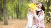 apple : Woman and child in autumn park Stock Footage