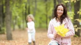 Woman and child in autumn park Stock Footage