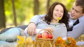 Young couple in autumn park. Dolly shot Stock Footage