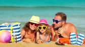 travel : Happy family having fun at the beach. Summer vacations concept. Slow motion Stock Footage