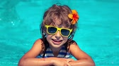 oynamak : Happy child having fun in swimming pool. Summer vacations concept. Slow motion Stok Video