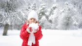 weather : Happy child blowing snow in winter park