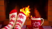 lareira : Womens feet in Xmas socks against fireplace