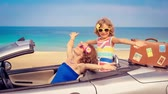 auto : Happy family travel by car on summer vacation. Slow motion