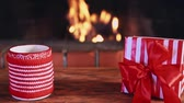 prezent : Christmas gift and cup of mulled wine against fireplace Wideo