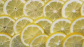 Lemon slices in water bubbles. Lemon background Wideo