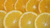 vitaminok : Orange fruit background. Orange slice. Seamless loop
