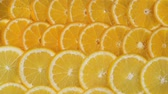 lime : Oranges slices in water bubbles. Juicy slices of oranges close-up