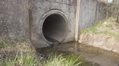 effluent : Waste water canal. The flow of water spilling from the pipe Stock Footage