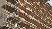 Scaffolding on side of building. Scaffolding used as working platform for workers to work