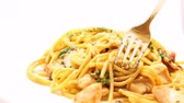 Close up of eating of pasta carbonara