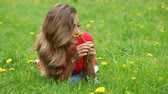 Woman smell dandelion