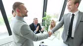Business people shaking hands, finishing up a meeting, business team applauding, bullet time effect