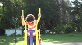 cubano : Hispanic boy or child exercising outdoors in a  hot summer day Stock Footage