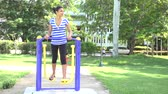 cubano : Hispanic girl exercising outdoors in a hot summer day.