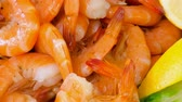 citrus fruit dish : Close up of a shrimp tray garnished with lemon. Delicious seafood plate
