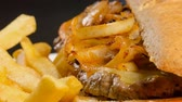 приправа : Caramelized onions pork steak served in a Kaiser bun with fries. Delicious snack meal
