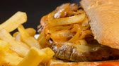 batatas fritas : Caramelized onions pork steak served in a Kaiser bun with fries. Delicious snack meal