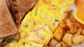 cubano : Delicious omelette with ham,peppers and cheese served with toasts and potatoes for a wonderful lunch snack