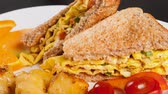 omelete : Delicious omelette sandwich served with potatoes and cherry tomatoes, a perfect quick lunch or snack